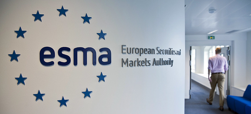 A visitor passes a sign in the lobby of the European Securities and Markets Authority's (ESMA) headquarters in Paris, France, on Thursday, June, 20, 2013. French gross domestic product will probably drop this year after stalling in 2012 as households trim spending and companies slash investment, national statistics office Insee predicted. Photographer: Balint Porneczi/Bloomberg