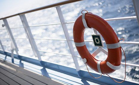 Life Preserver on Cruise Ship Railing --- Image by © Randy Faris/Corbis